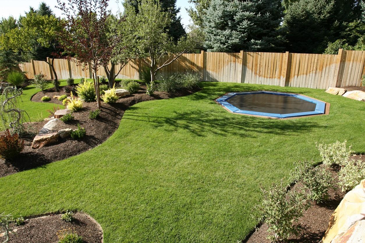 a green garden featuring a trampoline