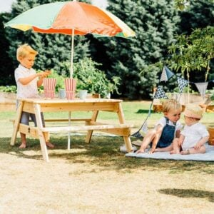 Children playing at picnic bench