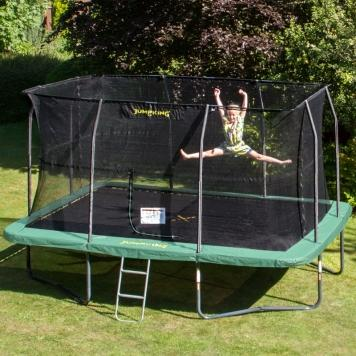 Child jumping on rectangle trampoline