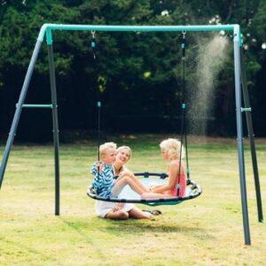 Children playing on Nest Swing